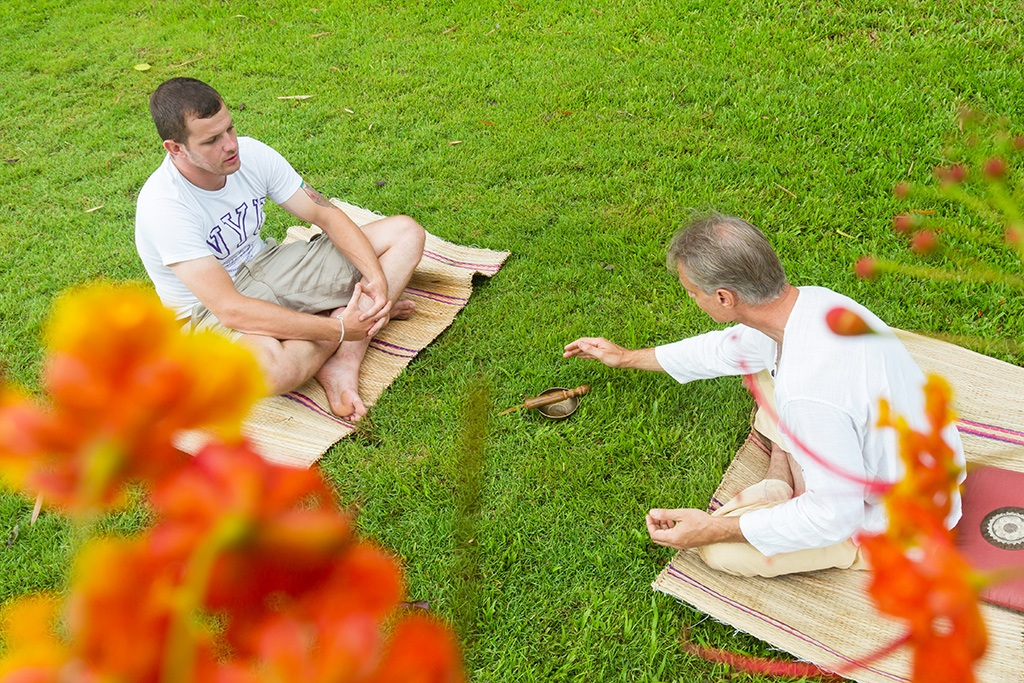 Two males having a mindfulness session as part of addiction treatment in Thailand