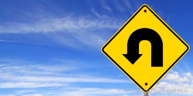a u-turn road sign
