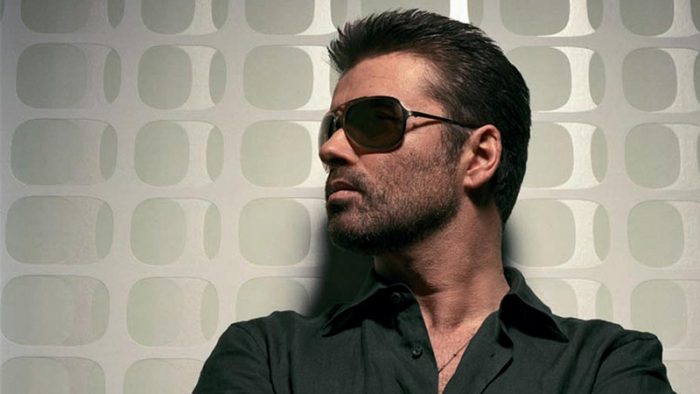 George Michael wearing dark sun glasses