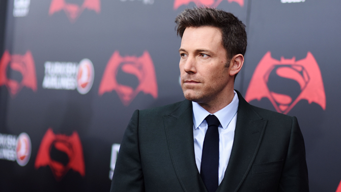 Ben Affleck wearing a suit and tie at a movie premier
