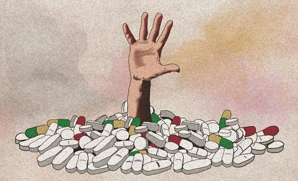 Hand reaching out of a pile of pills