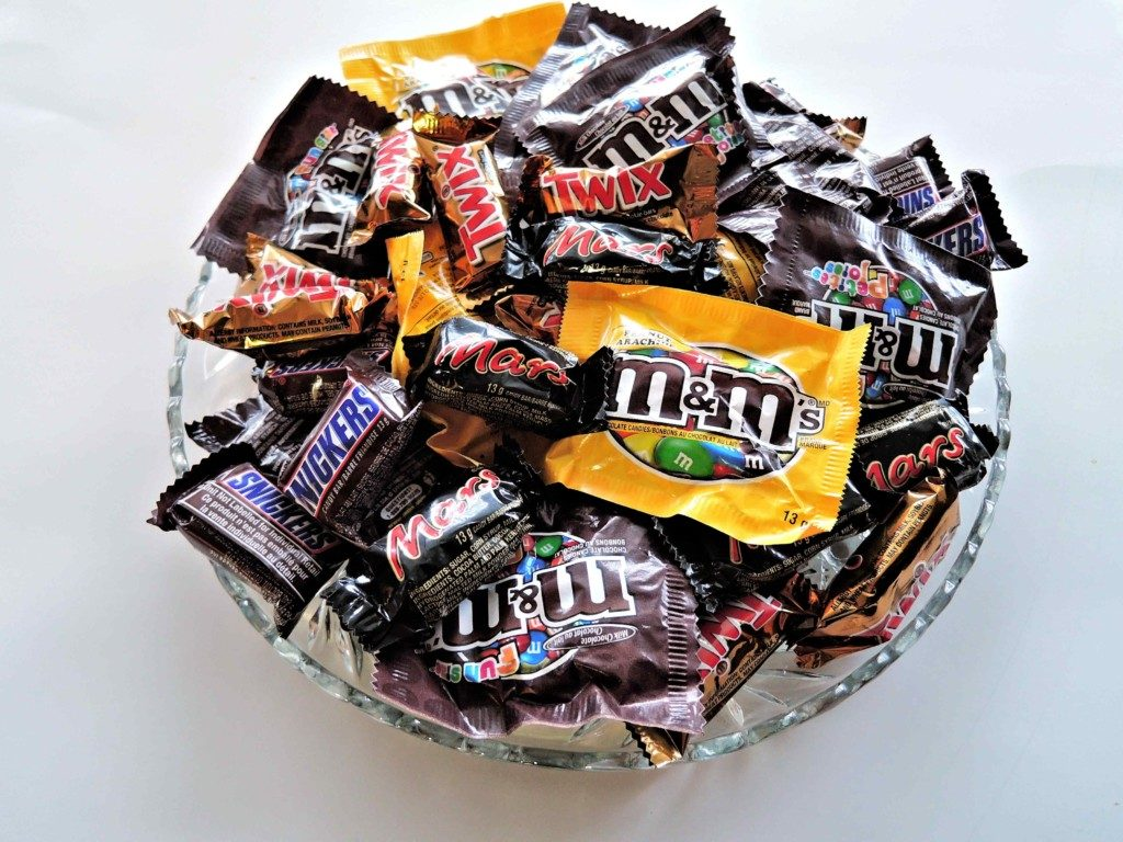 a bowl of various chocolate wraps