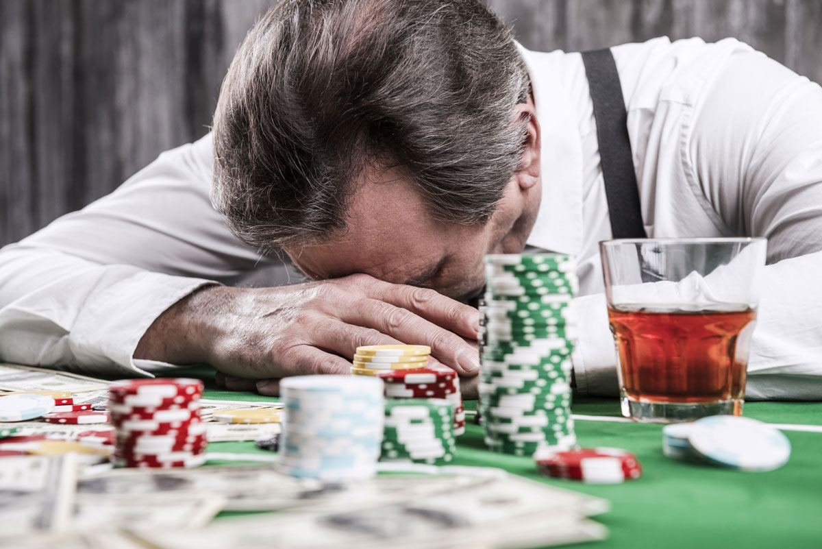 A devastated man loses big at a casino – sadly, a common outcome for heavy gamblers in the UK and Australia.