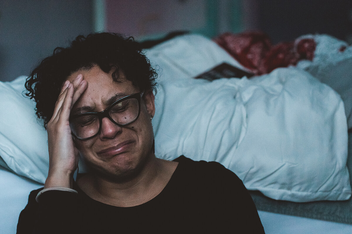 an adult female lives with her untreated depression.