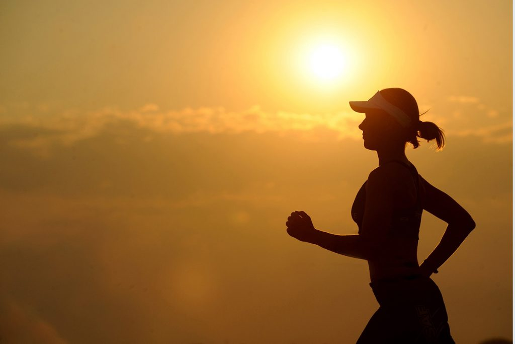 a woman practises jogging and exercising to cope with grief resulted from losses.