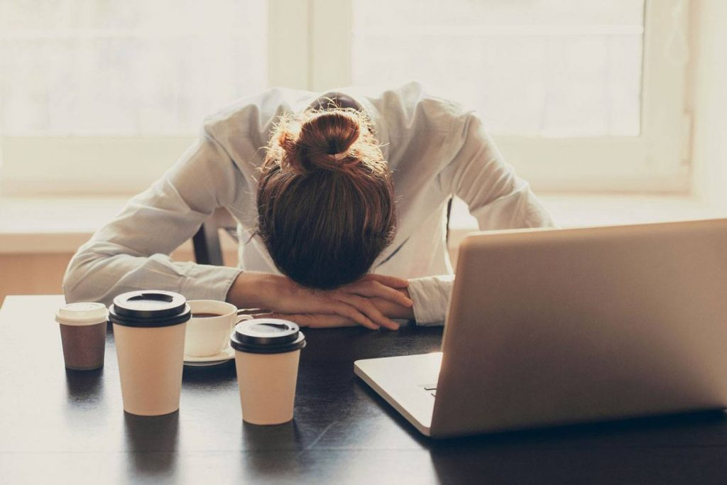 Business woman experiences the manic depression that causes her extreme exhaustion.