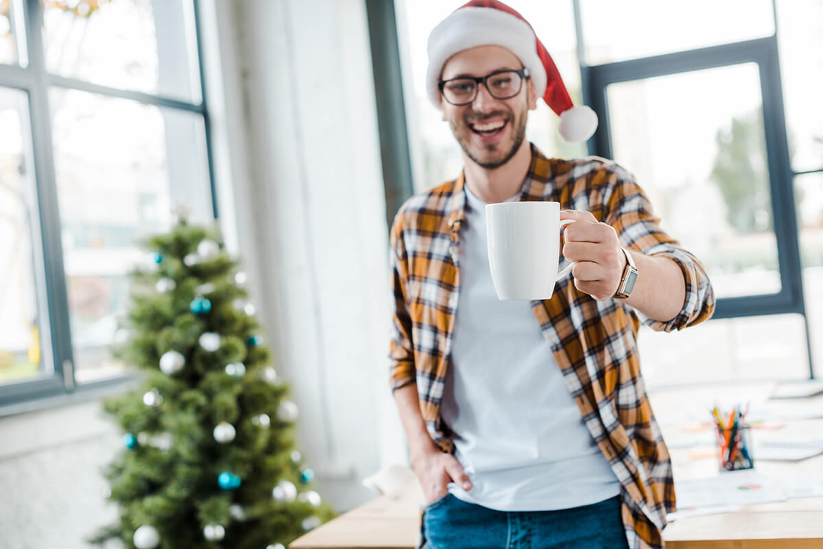 a man enjoys celebrating Christmas and New Year without alcohol drinking.
