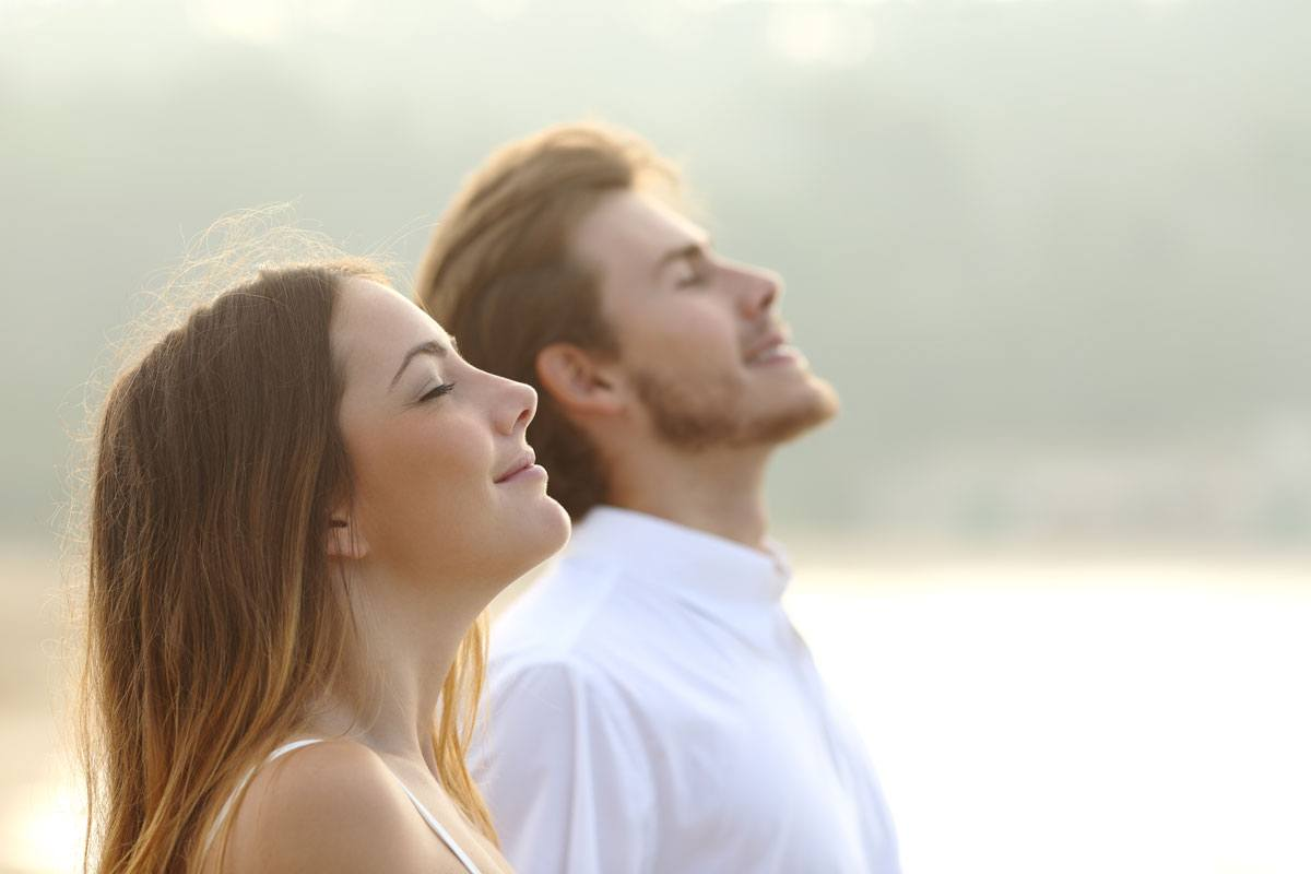 a woman and a man are ending their year-end with practising self-reflection and self awareness