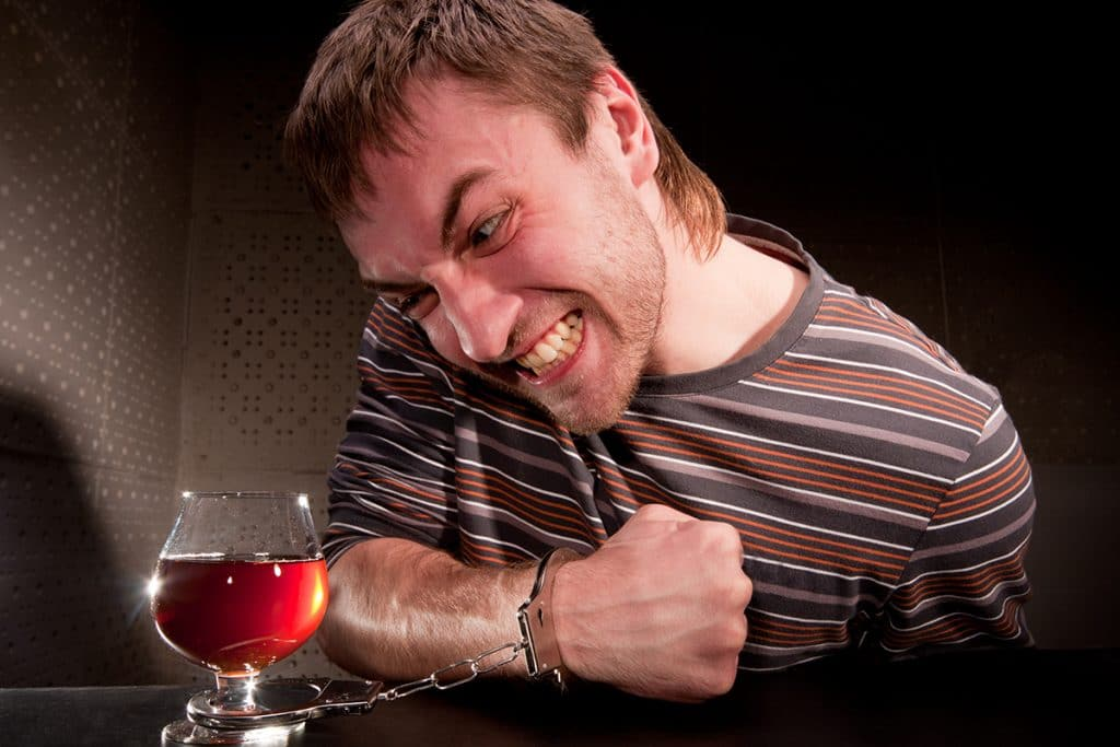 A man is struggling to stop his alcohol addiction