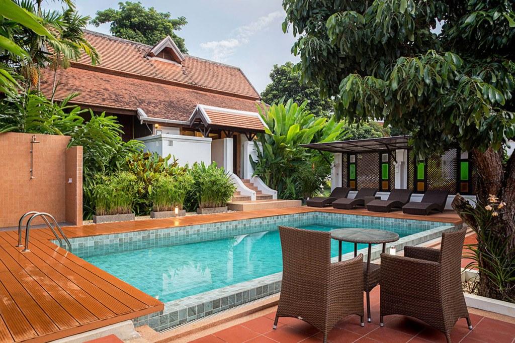A swimming pool, poolside lounge area and sauna facility